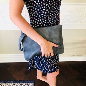 Brand new gray leather clutch